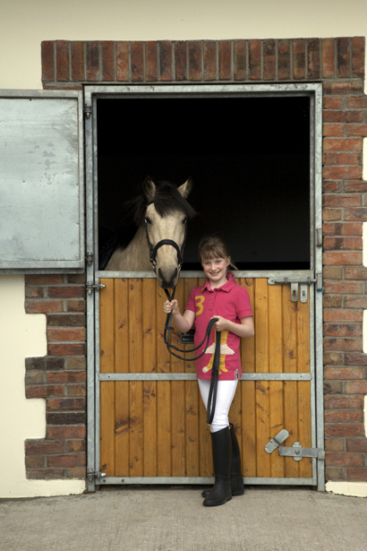 Little sister playing with her favourite pony by Ni Riain Photog