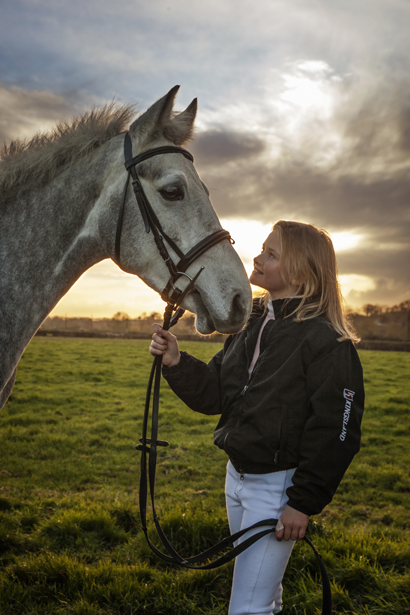 Young ponyclub rider and her showjumping pony and horse sunset W